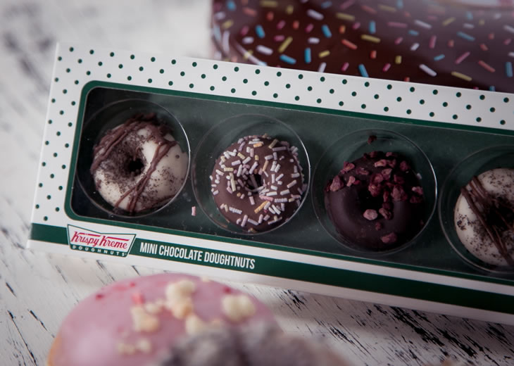 Mini chocolate doughnut selection gift box with Krispy Kreme gift tin in the background