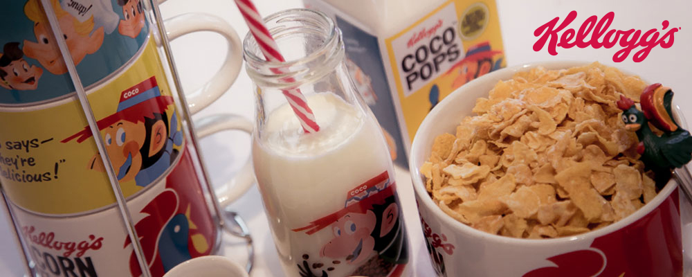 A range of gifts from Kellogg's including mugs and stand, Coco Pops kids milk bottle and Corn Flakes bowl with cereal