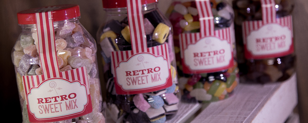 Four retro sweet mix tubs with classic sweet ranges