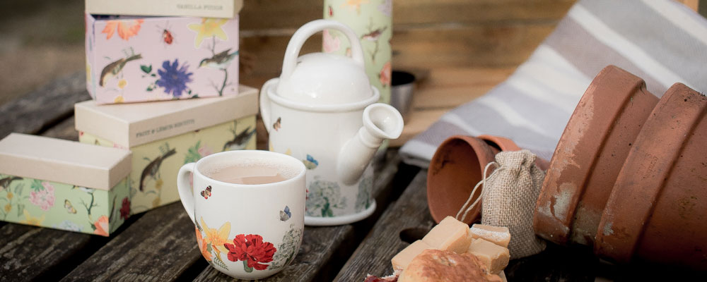 RHS tea set with watering can teapot and tea cup, with gift tea selection boxes