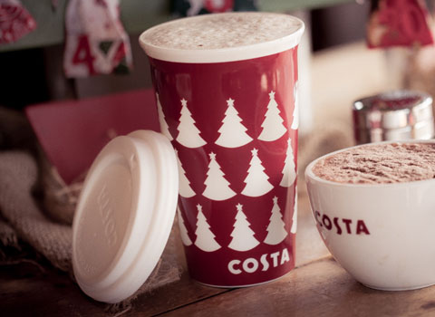 Costa mug of cappucino and a Christmas Costa cup with lid