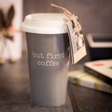 Tall travel cup with slogan 'But first coffee'