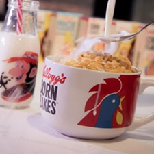Corn Flakes bowl and Coco Pops milk bottle with mini cereal boxes in the background