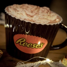 Reese's branded mug in the shape of a piece of Reece's confectionery